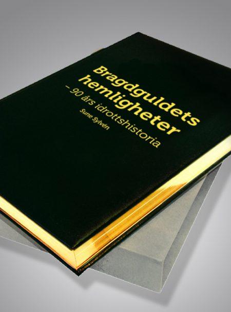 Bragdguldets hemligheter - 90 års idrottshistoria Bibliofilupplaga